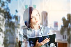 Education concept. Portrait of pretty young woman reading book on abstract summer city background. Education concept. Double exposure Royalty Free Stock Photo