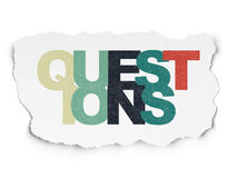 Education concept: Questions? on Torn Paper Stock Photo