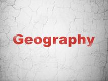 Education concept: Geography on wall background. Education concept: Red Geography on textured concrete wall background Stock Photo
