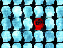 Education concept: red head with gears icon on. Education concept: rows of Pixelated blue head icons around red head with gears icon on Digital background, 3d Stock Photo