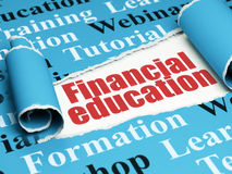 Education concept: red text Financial Education under the piece of torn paper. Education concept: red text Financial Education under the curled piece of Blue stock photography