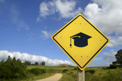 Education concept road sign with college hat icon Royalty Free Stock Images