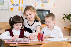 Education concept - School Students at the class. Back to school stock photo
