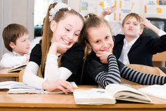 Education concept - School Students at the class. Back to school stock photography