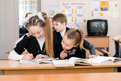 Education concept - School Students at the class. Back to school stock photos