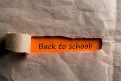 Education concept, 1 september time. Message at torn envelope - Back to school royalty free stock photography