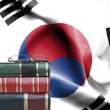 Education concept - Stack of books and reading glasses against National flag of South Korea royalty free stock photos