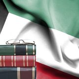 Education Concept - Stack Of Books And Reading Glasses Against National Flag Of Kuwait Royalty Free Stock Photos