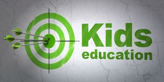 Education concept: target and Kids Education on wall background Royalty Free Stock Images
