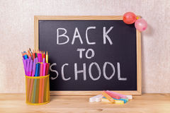 Education concept with text back to school is written in chalkbo Royalty Free Stock Photo