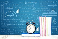 Education Concept. Text Books and arm clock on the wooden pallal Royalty Free Stock Photo