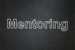 Education concept: Mentoring on chalkboard background. Education concept: text Mentoring on Black chalkboard background Stock Images