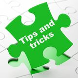Education concept: Tips And Tricks on puzzle background. Education concept: Tips And Tricks on Green puzzle pieces background, 3D rendering Royalty Free Stock Image
