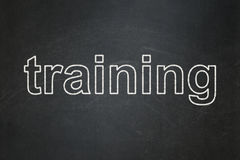 Education concept: Training on chalkboard Stock Image