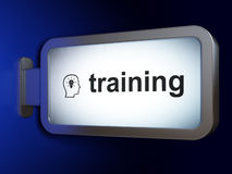 Education concept: Training and Head Whis Lightbulb on billboard. Education concept: Training and Head Whis Lightbulb on advertising billboard background, 3d Royalty Free Stock Image
