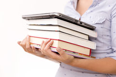 Education concept. Woman holding pile of books and laptop Royalty Free Stock Photography