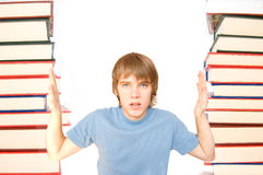 Education conceptual image. Young boy crushed with learning Stock Image