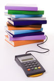 Education cost. Concept - POS terminal with a stack of colorful books (focus on the POS Stock Photography