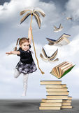 Education creative concept , child girl fly on book Royalty Free Stock Image