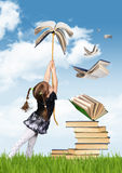 Education creative concept , child girl fly on book Stock Image