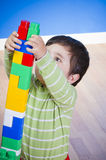 Education, cute little boy playing with blocks Stock Photo