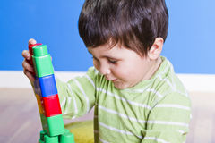 Education, cute little boy playing with blocks Stock Images