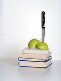Education cuts - putting the knife in metaphor. Government spending review, school reorganisation etc royalty free stock image