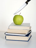 Education cuts on the way. Metaphor. Royalty Free Stock Photography