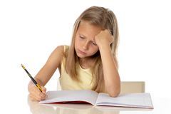 Young school student girl looking unhappy and tired in education concept stock photography