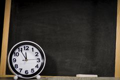 Concept sciences at the school, clock relating to the chalkboard. Education and exams concept, clock on school chalkboard background Stock Images