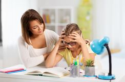 Mother helping daughter with difficult homework royalty free stock images
