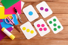 Education flash cards for kids. Learning colours. Teaching kids to count. Scissors, pencil, glue, colored cardboard sheets Royalty Free Stock Image