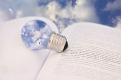 Education is food for the mind. Conceptual shot with lightbulb and book, education is empowering for the mind Royalty Free Stock Photography