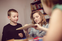 Education and fun. Kids with teacher playing games in classroom Stock Photography