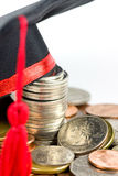 Education fund -- Graduation cap & coins Stock Photo