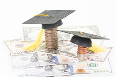 Education Fund. Mortarboards and US coins and banknotes close up royalty free stock photos