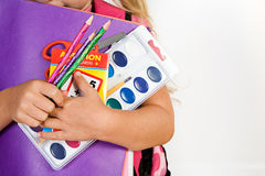 Education: Girl Holds Armful Of School Supplies Royalty Free Stock Image