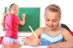 Education , girl writing on blackboard Stock Photos