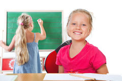 Education , girl writing on blackboard Stock Images