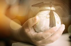 Education in Global, Graduation cap on Businessman holding Earth globe model map with Radar background in hands. Concept of global. Business, abroad educational royalty free stock photos