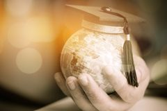 Education in Global, Graduation cap on Businessman holding Earth globe model map with Radar background in hands. Concept of global. Business, abroad educational stock photos