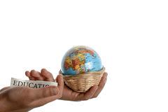 Education and globe. Education in one hand and globe in one hand in a basket Royalty Free Stock Image
