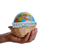 Education and globe. Education in one hand and globe in one hand in a basket royalty free stock photos