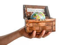 Education and globe. Education sign and a globe in a chest box on a white background stock photo