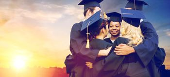 Happy students or bachelors hugging Royalty Free Stock Image