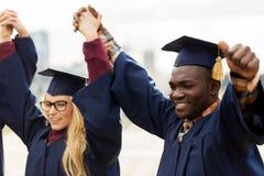 Happy students celebrating graduation stock photography