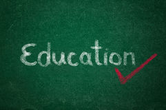 Education on green chalkboard Stock Photos