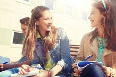 Group of students with notebooks at school yard royalty free stock photography