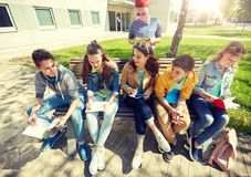 Group of students with notebooks at school yard. Education, high school and people concept - group of happy teenage students with notebooks learning at campus Stock Photo