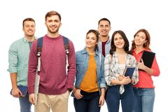 Group of smiling students with books stock photography
